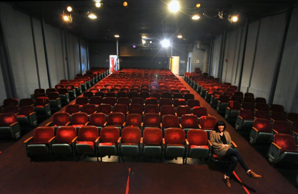 "Jaime Jensen, manager of the Pittsfield Community Theatre, says she saw her first movie, ""E.T. the Extra-Terrestrial,"" at the theater, which opened in 1915. The Town Council has decided to close and sell the venue."