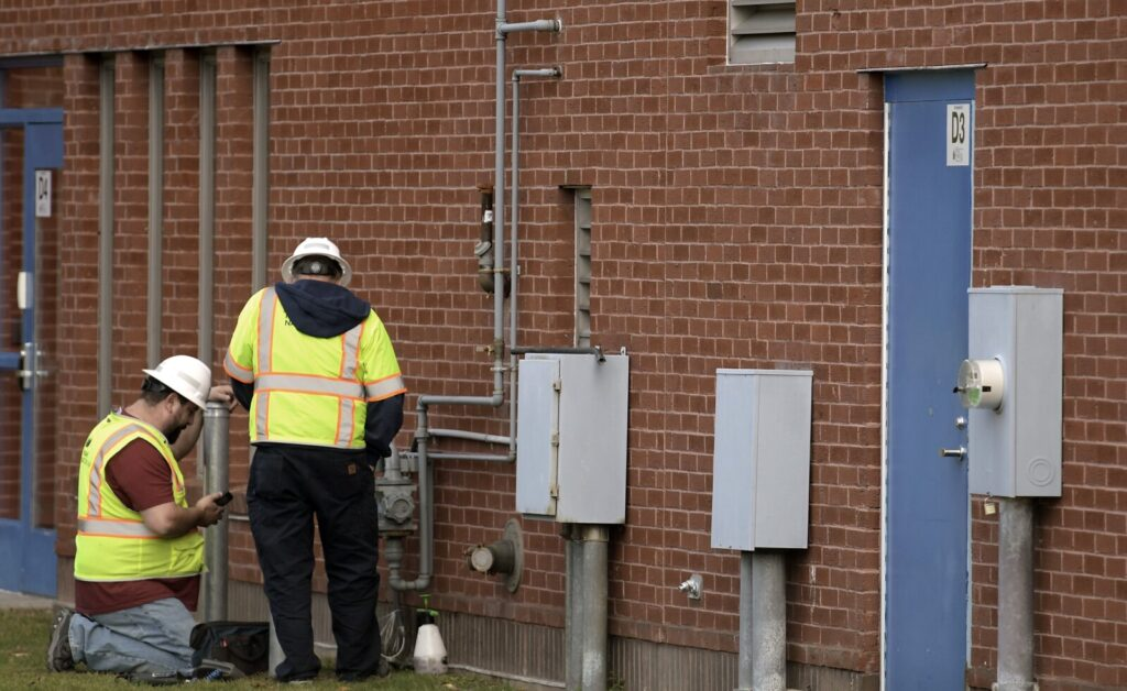 Natural gas technicians examine the service at the Maine State Police Crime Laboratory in Augusta on Thursday after a leak was reported at the building.