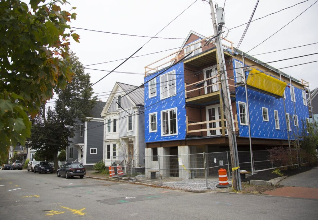 A multi-family home is under construction on O'Brion Street in Portland. The city has approved an abundance of new construction, but there are delays in finishing projects. And of those new homes on the market, many are unaffordable to a majority of city residents, according to a new report.