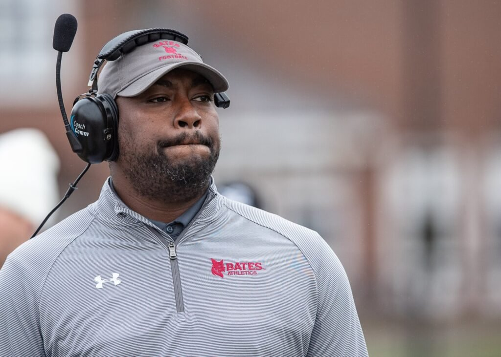 Bates head football coach Malik Hall looks at the scoreboard in this file photo from 2019.