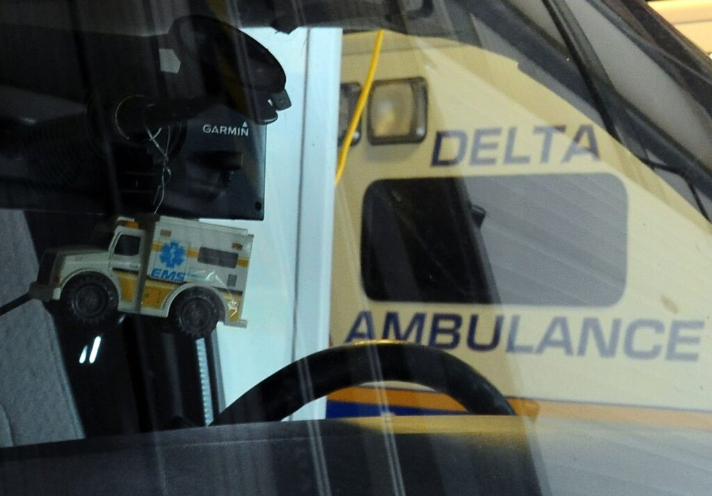 A toy ambulance hangs from the rearview mirror of a Delta Ambulance at the company's facility in Waterville. Delta currently provides ambulance service to 17 communities, including Waterville.