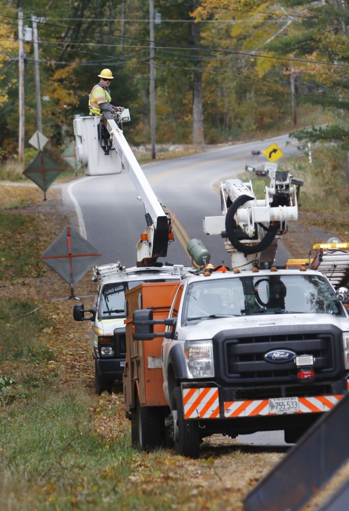 Central Maine Power crews work to restore power along School Street in Alfred following a Nor'easter that blew through the region in this file photo from October 2019.