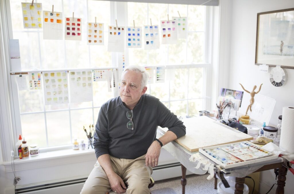 David Pearce at his home painting studio in Yarmouth. Pearce is focusing on his art after a long career as both a diplomat and a journalist overseas.