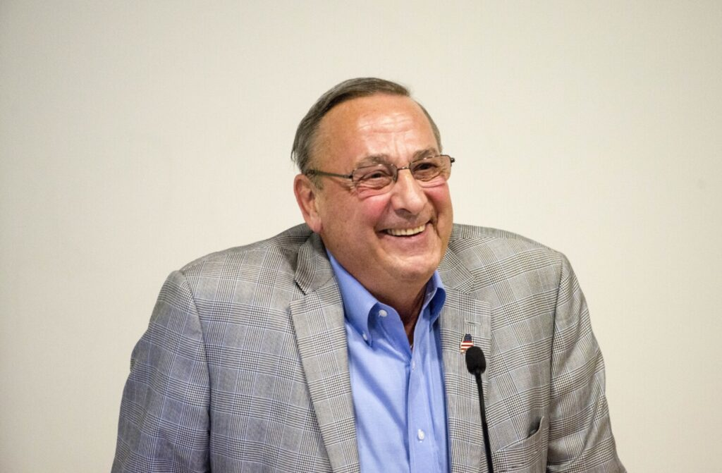 Former Maine Gov. Paul LePage laughs as he fields a question from the audience Wednesday during his talk at Ostrove Auditorium at Colby College in Waterville.