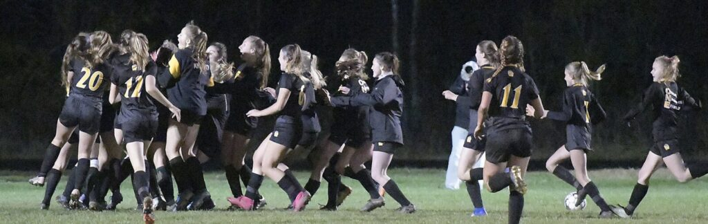 Maranacook players celebrate their Class C South quarterfinal victory over Waynflete on Tuesday in Readfield.