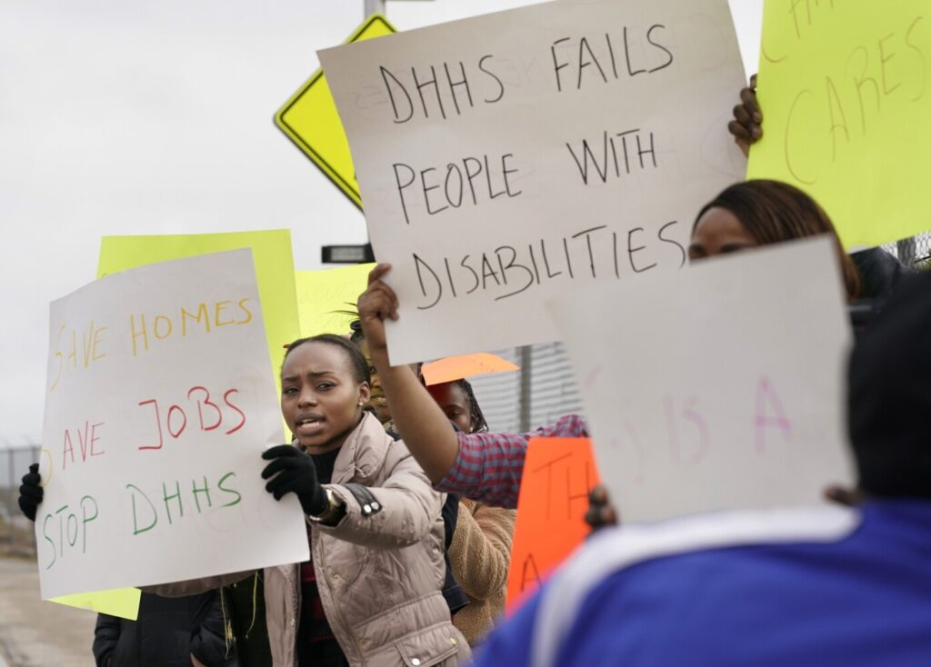 Deborah Bafongo, a house supervisor with Residential Care and Support Services, protests with other RCSS employees near the Department of Health and Human Services office in South Portland on Oct. 28. About 40 RCSS employees protested because the state canceled its contract with RCSS after a man with intellectual disabilities died in one of its homes in August.