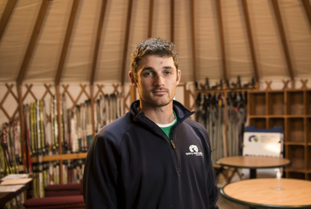 Justin Fereshetian, program director and ski coach for Quarry Road Trails, stands for a portrait in the warming yurt at Quarry Road on Thursday.