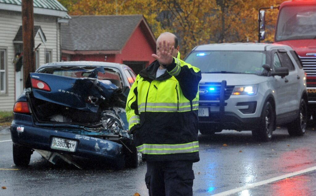 Firefighters work a multi-vehicle accident Wednesday outside the Hinckley General Store at 764 US Route 201 in Hinckley.