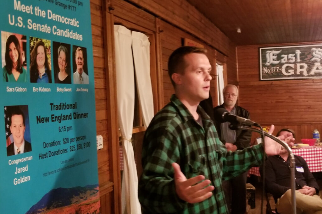 U.S. Rep. Jared Golden addressed Democrats at the Piscataquis County Democratic Committee's annual fundraising dinner at the East Sangerville Grange Hall.