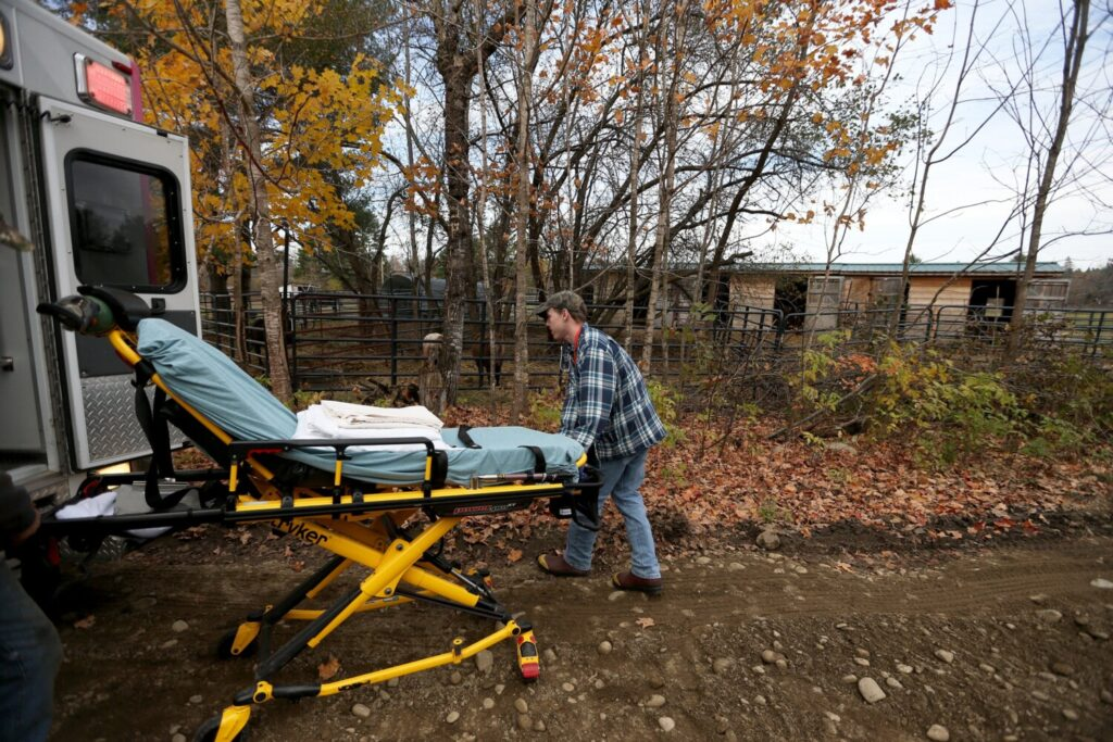 Evan Dorr, an EMT with Industry Fire and Rescue, prepares a stretcher for a 69-year-old fall victim. Dorr and his partner were first on the scene while an ambulance crew from Farmington was making the 15-mile drive.
