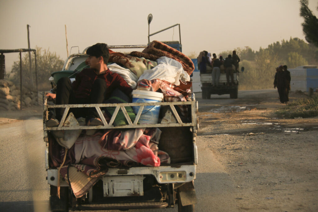 Syrians flee shelling by Turkish forces in Ras al Ayn, in northeast Syria, on Wednesday. Turkish President Recep Tayyip Erdogan announced Wednesday the start of a Turkish military operation against Kurdish fighters in northeastern Syria.