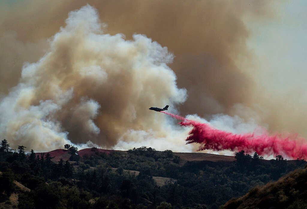 A tanker drops retardant Oct. 11 on the Saddleridge fire burning in Newhall, Calif.