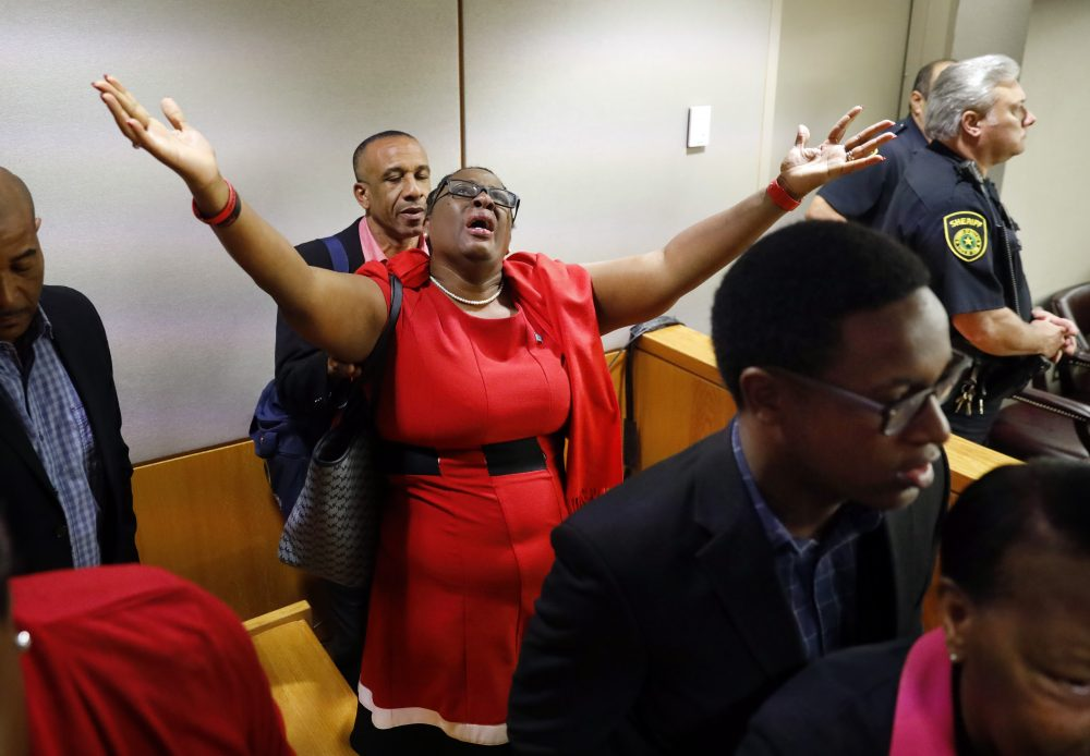 Botham Jean's mother, Allison Jean, rejoices in the courtroom Tuesday after fired Dallas police Officer Amber Guyger was found guilty of murder. Guyger shot and killed Botham Jean, an unarmed 26-year-old neighbor in his own apartment last year. She told police she thought his apartment was her own and that he was an intruder.