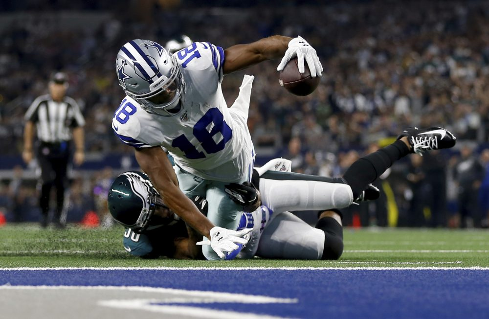 Dallas wide receiver Randall Cobb is stopped shy of the end zone after catching a pass Sunday night in Arlington.