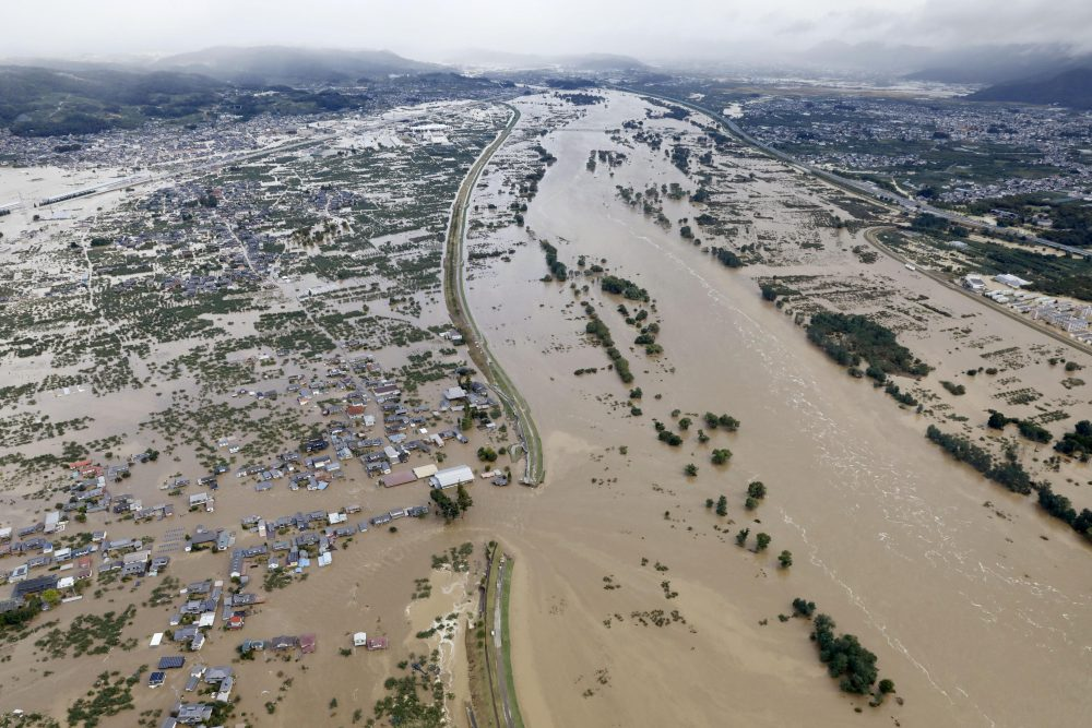 Residential areas are submerged in muddy water Sunday after an embankment of the Chikuma River broke because of Typhoon Hagibis, in Nagano, central Japan.