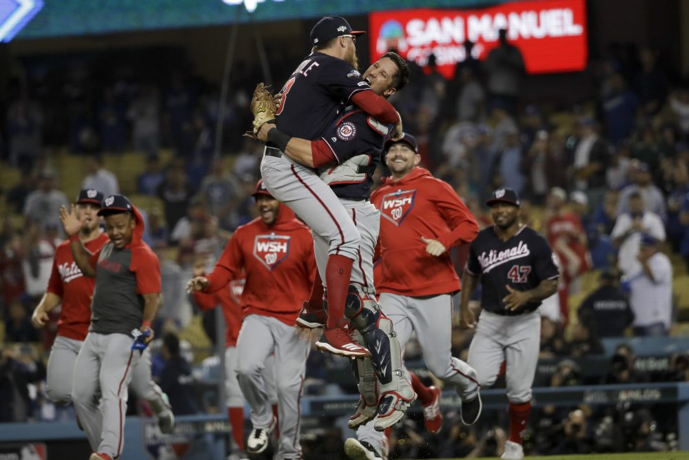 Washington Nationals pitcher Sean Doolittle, left, and catcher Yan Gomes leap in celebration after the team's 7-3 win in Game 5 of a baseball National League Division Series against the Los Angeles Dodgers on Wednesday.