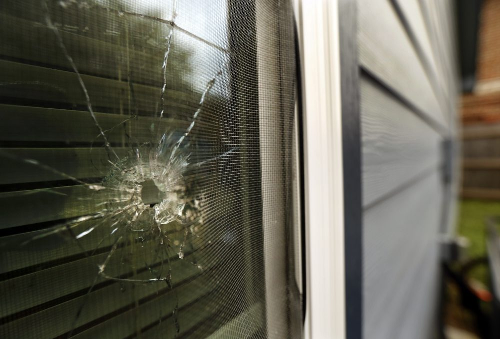 A bullet hole from the Fort Worth, Texas, police officer's shot is seen in the rear window of Atatiana Jefferson's home Tuesday. Jefferson, a black woman, was shot by a white police officer early Saturday.