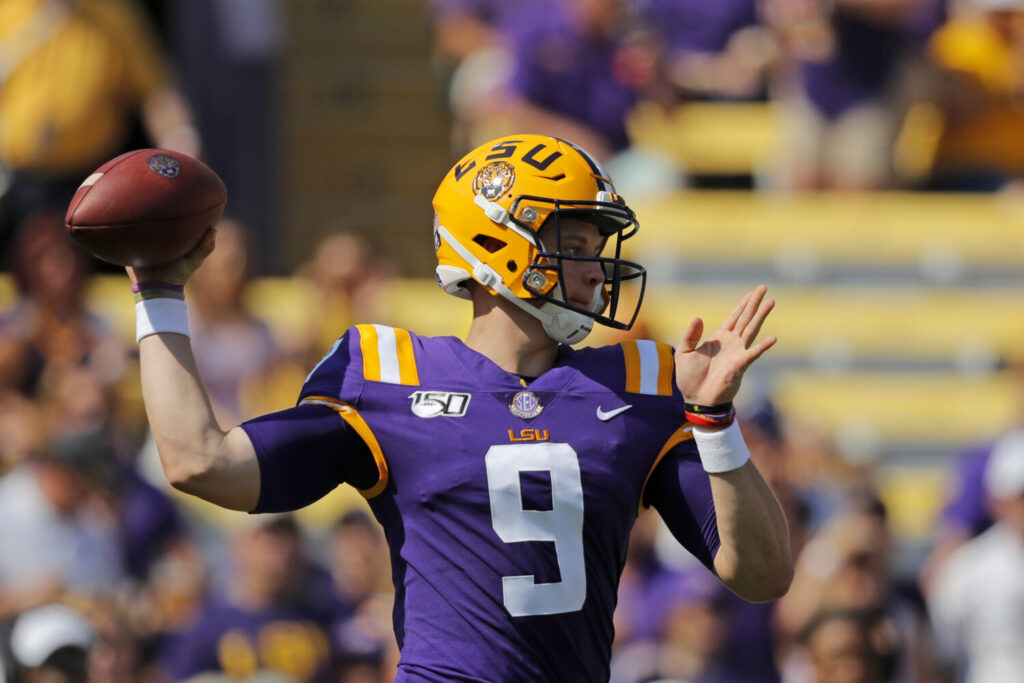 LSU quarterback Joe Burrow became the first quarterback to pass for more the 300 yards in four straight games and threw for five touchdowns to help the Tigers beat Utah State 42-6 on Saturday in Baton Rouge, La.