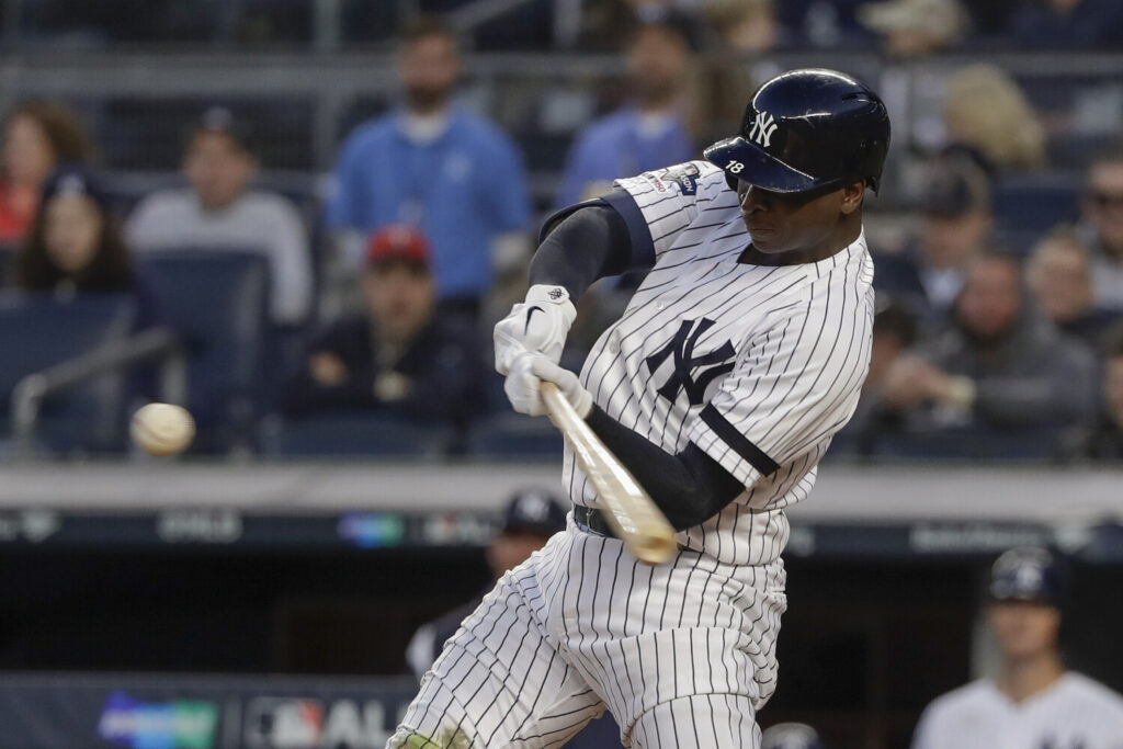 Didi Gregorius connects for a grand slam home run for New York against the Minnesota Twins during the third inning of Game 2 of an American League Division Series on Saturday.