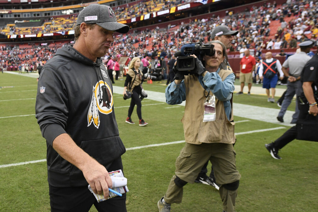 Washington Coach Jay Gruden leaves the field after his team fell to 0-5 with a 33-7 loss to the New England Patriots on Sunday.