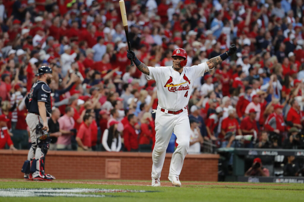 Yadier Molina celebrates after hitting a sacrifice fly to give the Cardinals a 5-4 win over the Atlanta Braves in Game 4 of the NLDS on Monday in St. Louis. Game 5 is Wednesday in Atlanta.