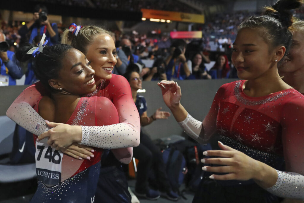 Simone Biles, left, gets hugs from her teammates after her floor exercise, clinching the gold medal in the women's team final at the Gymnastics World Championships in Stuttgart, Germany on  Tuesday. Matthias Schrader/Associated Press