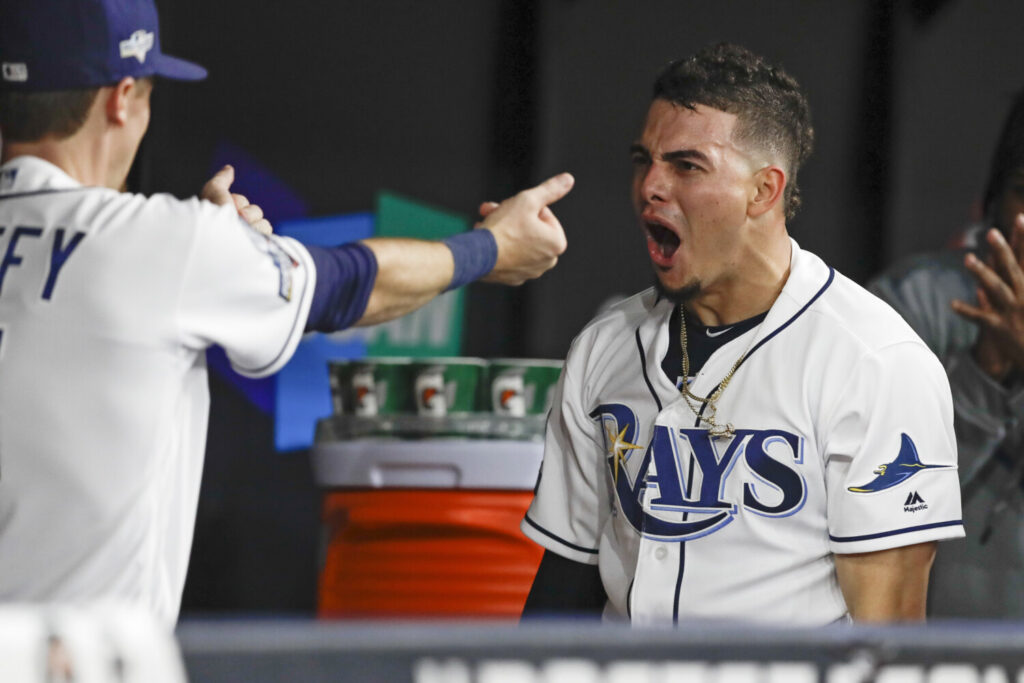 Tampa Bay's Willy Adames, right, celebrates his solo home run against the Houston Astros during the fourth inning of Game 4 Tuesday in St. Petersburg, Fla