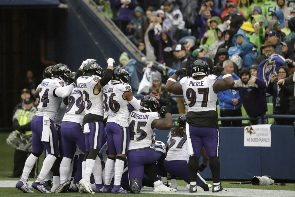 The Baltimore Ravens return from their bye week to prepare for a Sunday night matchup with the unbeaten New England Patriots.