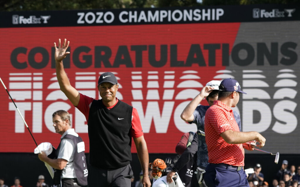 Tiger Woods celebrates after winning the Zozo Championship PGA Tour on Monday at the Accordia Golf Narashino country club in Inzai, east of Tokyo, Japan. It was Woods' record-tying 82nd PGA Tour victory.