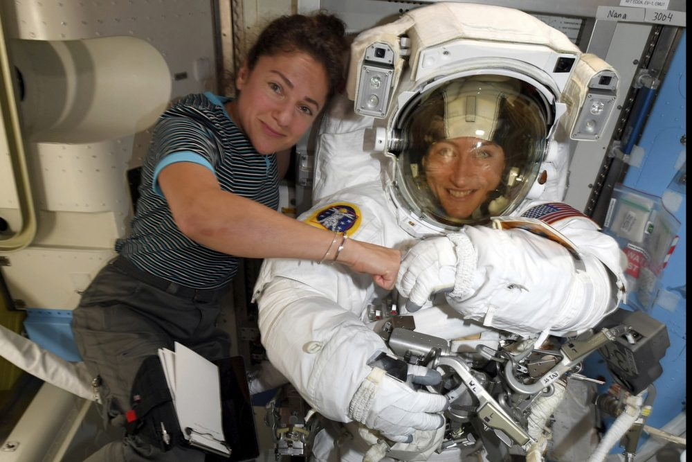 Astronauts Christina Koch, right, and, Jessica Meir pose for a photo on the International Space Station. NASA has moved up the first all-female spacewalk to Thursday or Friday because of a power system failure at the International Space Station.