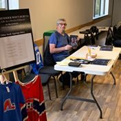 """Allan Globensky, former hockey player and Kennebec Ice Arena manager, signs copies of his book, """"A Little Knock Won't Hurt Ya!"""""""