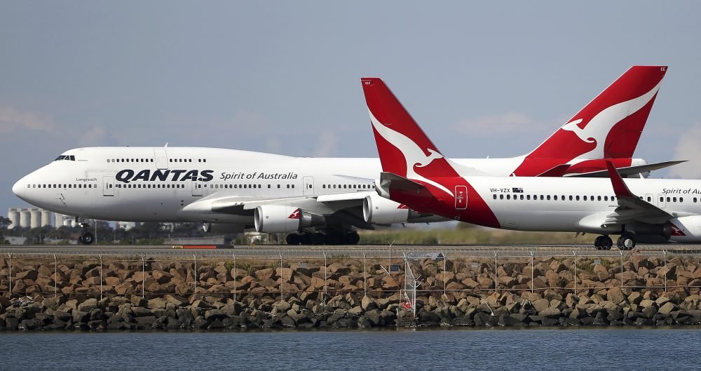 Two Qantas planes taxi on the runway at Sydney Airport in Australia in 2015. Australia's Qantas completed the first nonstop commercial flight from New York to Sydney on Sunday.