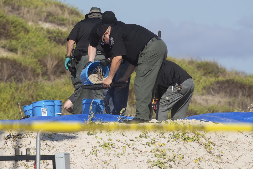 Several state agencies conduct an investigation on a Padre Island, Texas, beach in Kleberg County after two bodies were found there, on Monday.