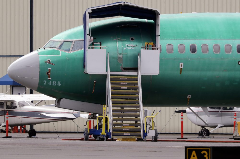 In this April 8, 2019, file photo a Boeing 737 MAX 7 jet is parked near single engine planes at the airport adjacent to a Boeing Co. production facility in Renton, Wash.