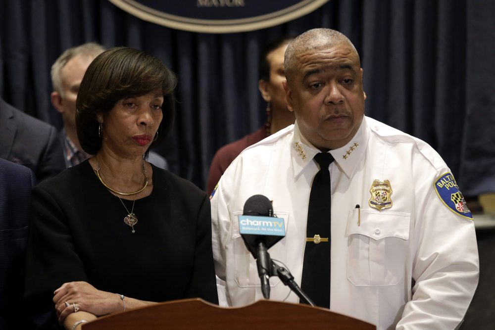 Baltimore Mayor Catherine Pugh and Michael Harrison, acting commissioner of the Baltimore Police Department, speak at a news conference in Baltimore earlier this year. Harrison said the suspect in a 2-year-old's shooting remains at large.