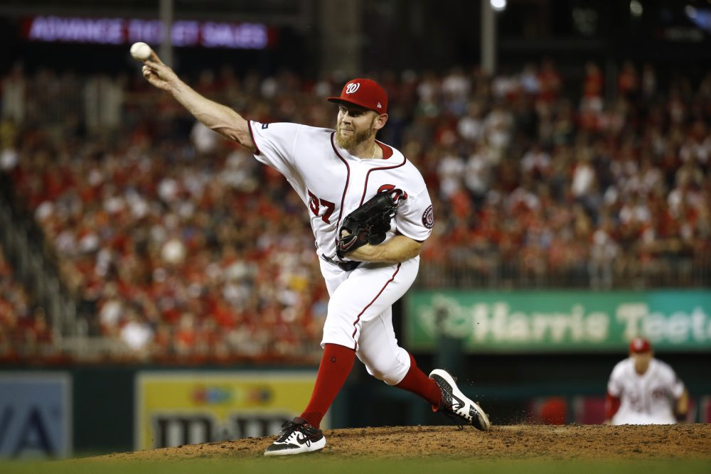 Washington Nationals relief pitcher Stephen Strasburg throws to the Milwaukee Brewers in the sixth inning Tuesday night in Washington. The Nationals erased a two-run deficit in the eighth inning to win.