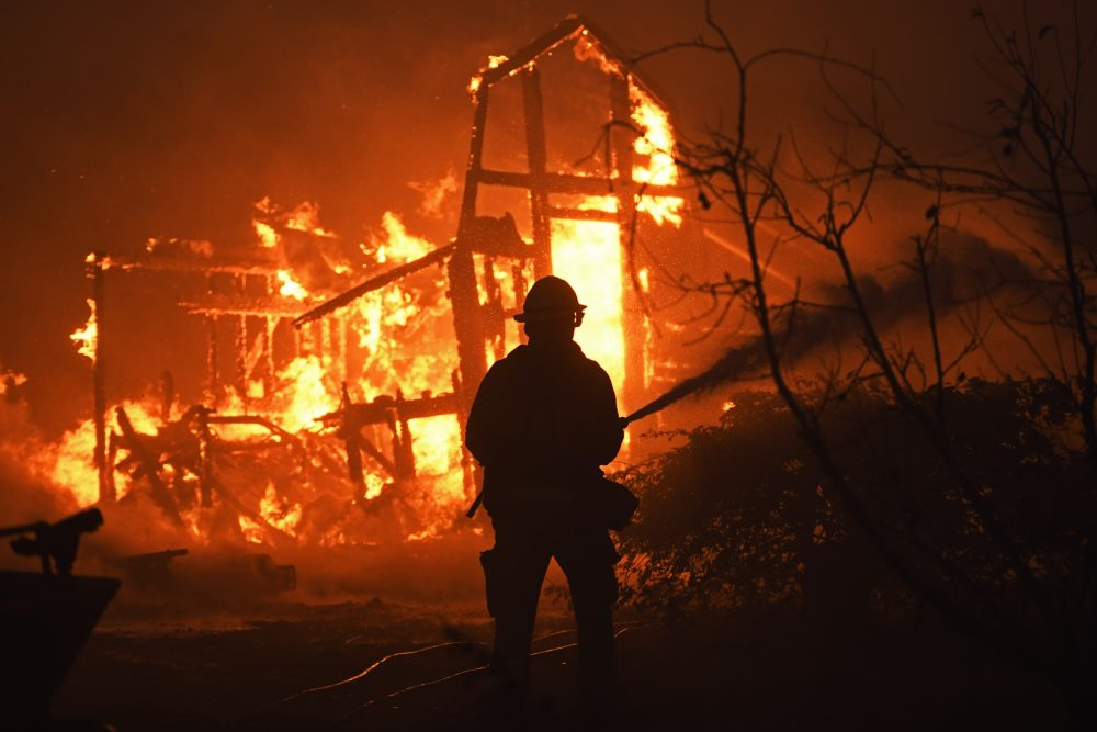 A firefighter battles a grass fire in Knightsen, Calif., on Oct. 27.