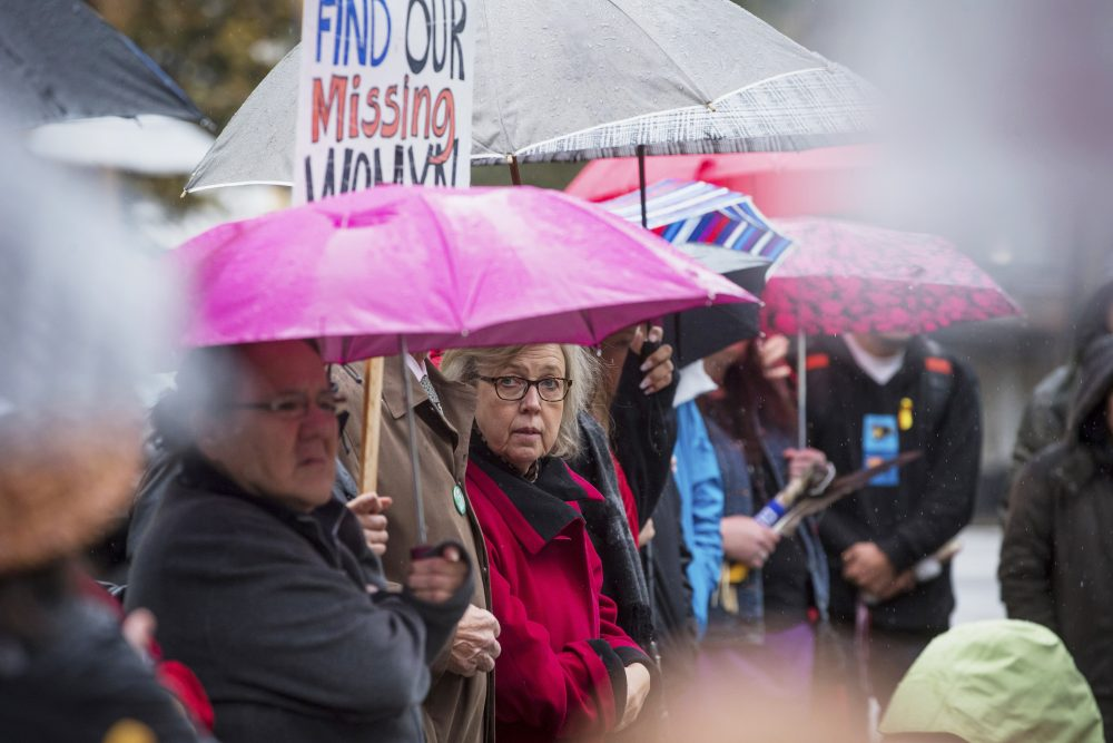 Green Party leader Elizabeth May listens to speeches before participating in a march calling for justice for missing and murdered Indigenous women and girls Sunday in Vancouver, British Columbia.