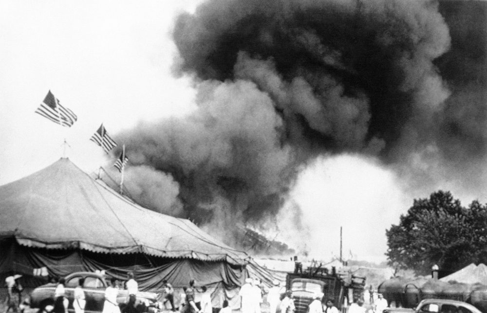 People flee a fire in the big top of the Ringling Brothers and Barnum & Bailey Circus in Hartford, Conn., on July 6, 1944. Authorities are exhuming the bodies of two victims in hopes of identifying a Vermont woman who has been missing since then.