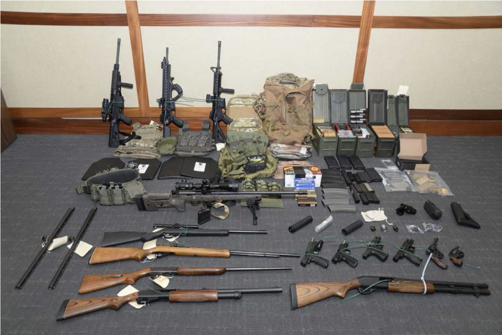 """A photo of firearms and ammunition that was in the motion for detention pending trial in the case against Christopher  Hasson. Prosecutors say that Hasson, a Coast Guard lieutenant is a """"domestic terrorist"""" who wrote about biological attacks and had a hit list that included prominent Democrats and media figures."""