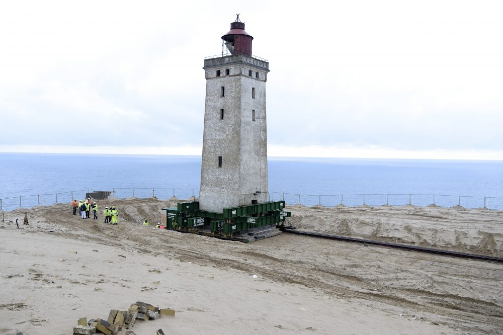 The Rubjerg Knude Lighthouse was put on wheels and rails in order to be moved 263 feet away from the North Sea in Jutland, Denmark, on Tuesday to protect it from coastal erosion.