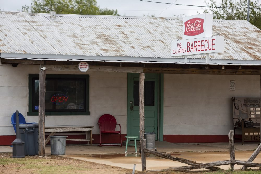 "This Oct. 11, 2019 photo shows The Gas Station in Bastrop, Texas,  famous for its appearance in the cult horror classic, ""The Texas Chain Saw Massacre."" Today it also serves barbecue and sells horror-related merchandise."