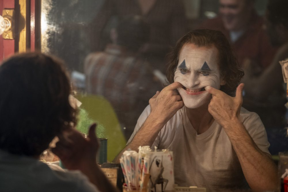 "This image released by Warner Bros. Pictures shows Joaquin Phoenix in a scene from ""Joker,"" in theaters on Oct. 4."