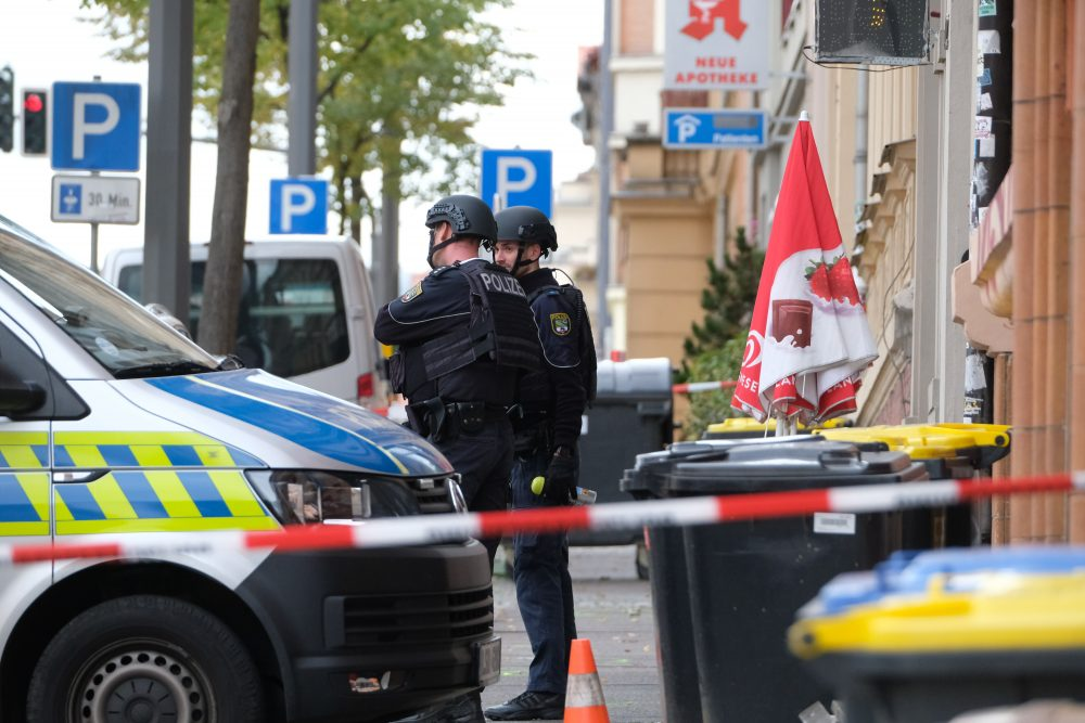 Police officers are on the scene of a shooting in Halle, Germany, on Wednesday that left two people dead.