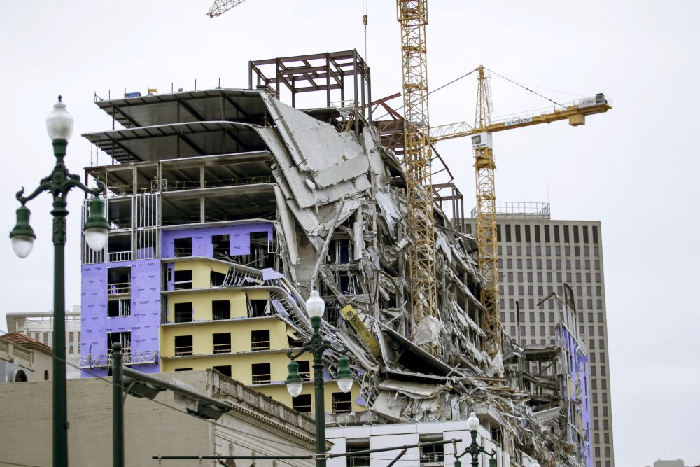 Debris hangs on the side of the building after a large portion of a Hard Rock Hotel, under construction suddenly collapsed in New Orleans on Saturday.