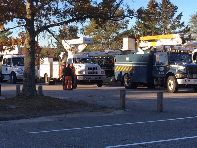 CMP and contractor trucks sit gathered at an impromptu staging area in front of Cape Elizabeth High School on Saturday morning.