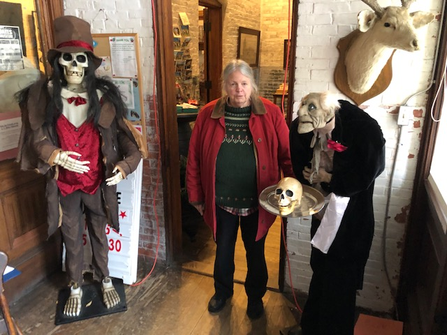 Deborah Staber, director and curator of LC Bates Museum with creepy creatures who greet visitors just inside the door during tour of the Halloween display in Hinkley October 27.