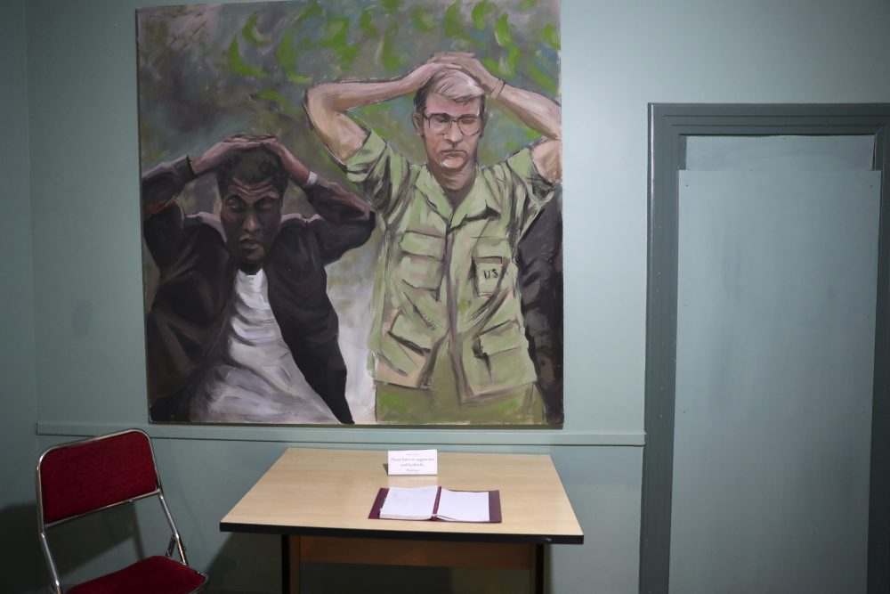 A painting of one of the images of the takeover of U.S. Embassy in Tehran in 1979, which shows U.S. Marine Sgt. Ladell Maples of Earle, Ark., left, and Cpl. Steve Kirtley of Little Rock, Ark., with their hands above their heads, adorns a wall of the embassy, now partly a museum, in Tehran, Iran.  Images like those of surrendering American troops carry a strong resonance for hard-liners in Iran.