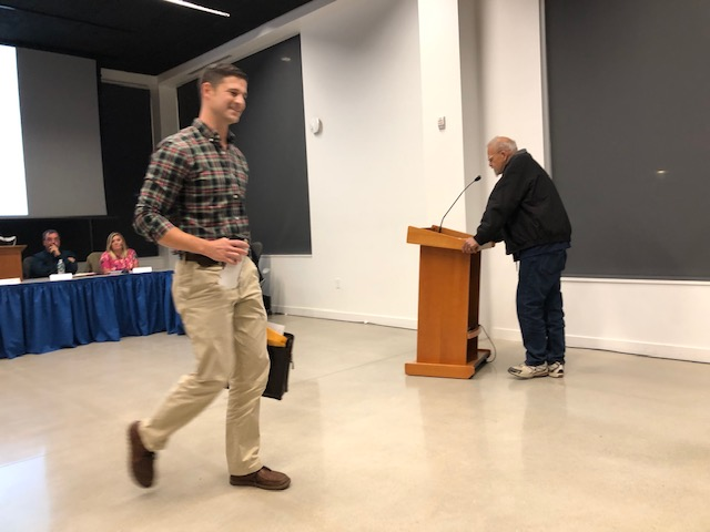 Waterville Mayor Nick Isgro leaves the council meeting early on Tuesday night. Later in the week he posted a letter online claiming councilors conspired with a resident who planned to attack him at Tuesday's meeting.
