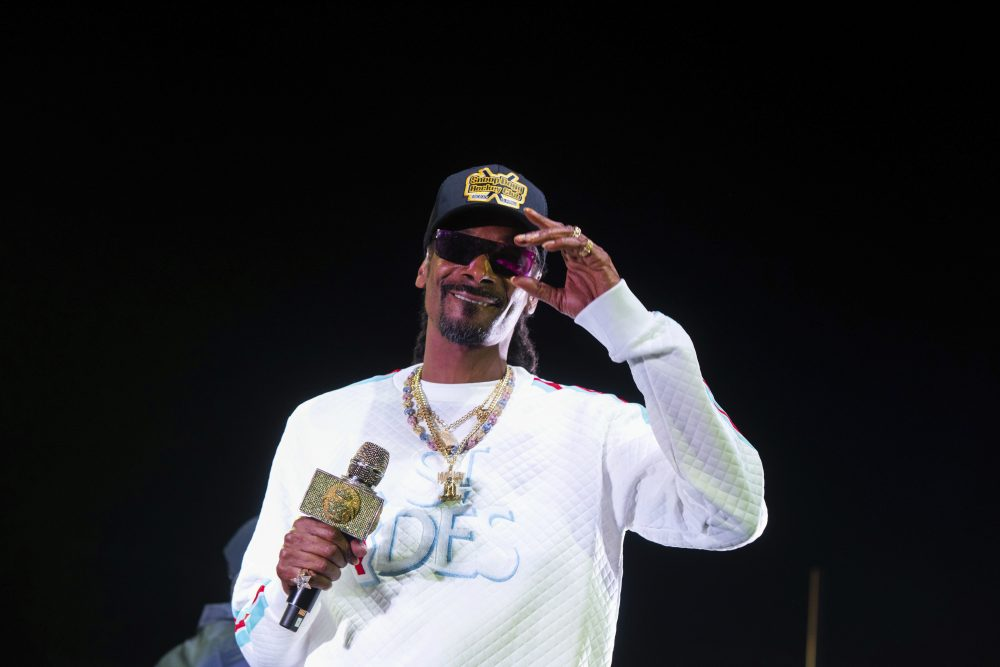 Snoop Dogg's performance at the University of Kansas' basketball kickoff included pole dancers and fake money shot over recruits' heads.